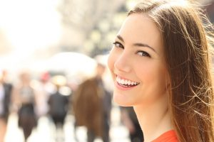 person with healthy glowing smile