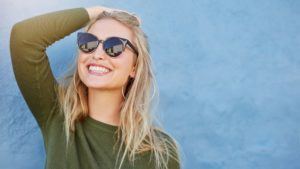 woman smiling with sunglasses